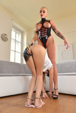 Young dyke Mona Kim has her bare ass flogged by latex garbed blond Kayla Green 29942745