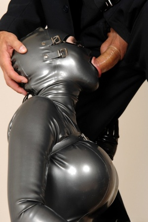 Latex attired woman is placed into bondage trunk before vaginal fucking