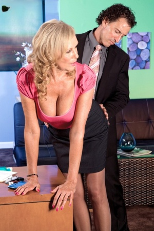 Horny old woman Bethany James seduces a man in black skirt and shiny pantyhose