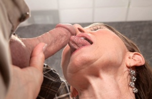Horny older woman Donna Davidson blows a black stud and her photographer