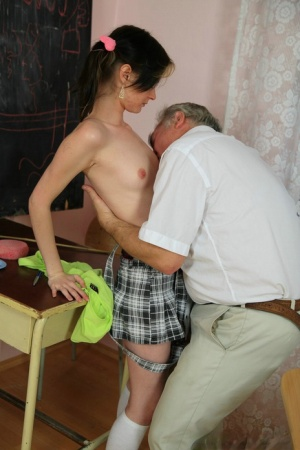 Skinny brunette finger spreads her pussy while doing anal with old teacher