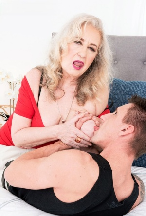 Horny oma Blair Angeles seduces a young boy for sexual relations