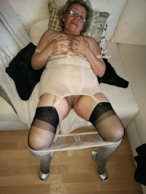 Old granny dildos her pussy in sheer nylons and garter ensemble 42418787