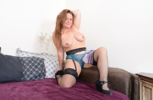 Thick mom uncups her big hangers before dildoing in mesh stockings