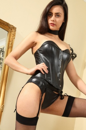 Solo model Maria Smith sets her firm tits free a latex corset