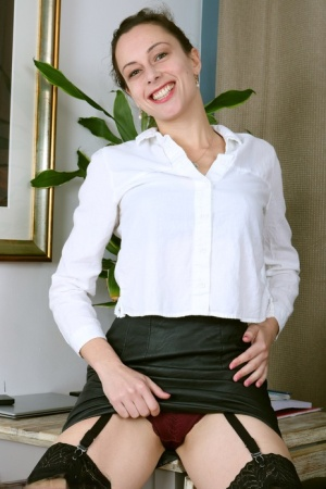 Over 30 secretary Abi strips to sheer nylons and garters in office chair