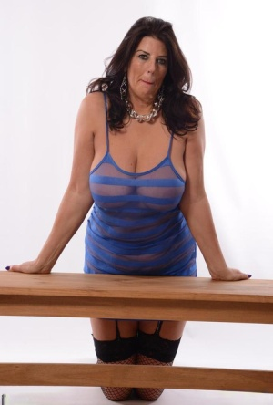 Amateur model Lu Lu Lush unleashes her giant breasts on wooden table