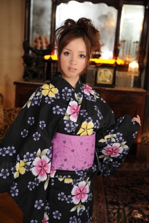 Japanese teen with a pretty face models non nude in floral print kimono
