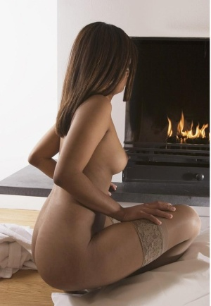 Hot Indian girl with firm breasts shows her bare and bald twat in stockings