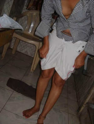 Indian woman takes off her shorts before slipping underwear over her butt
