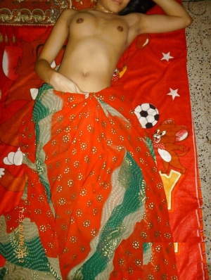 Indian solo girl slides upskirt panties aside before showing her bare breasts