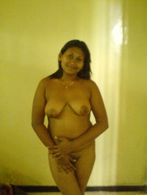 Chubby Indian chick gets completely naked on top of her bed