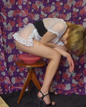 Redhead maid takes a pee into a bowl while on her menstrual cycle