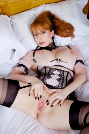 Solo woman Red XXX doffs hot lingerie before a finger fuck in FF nylons