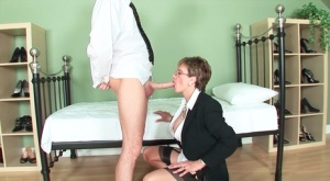 Mature woman Lady Sonia blows her husband while shes dressed for work