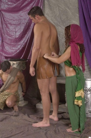 Amateurs Eve and Adam are freed from chains before MMF action with a Gladiator