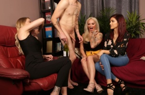 Clothed women strip a man naked and suck his dick over glasses of wine