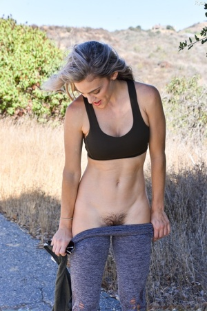 Amateur chick with big tits masturbates before exposing her ass on a trail