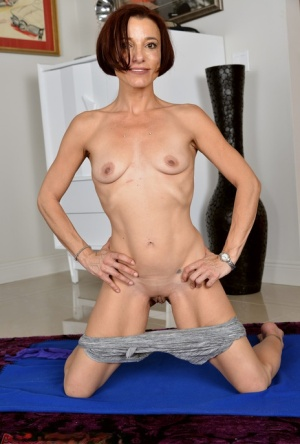 Thin 30 plus woman Stella Banks shows off her amazing flexibility in the nude