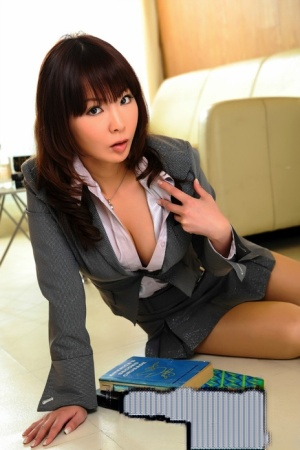 Hot Japanese secretary shows some cleavage and leg while posing non nude