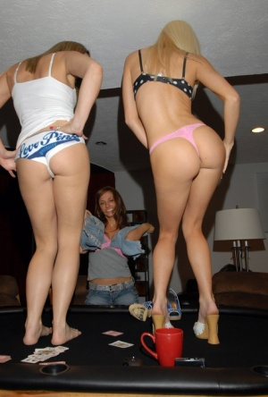 Amateur chicks with lesbian leanings undress while playing strip poker