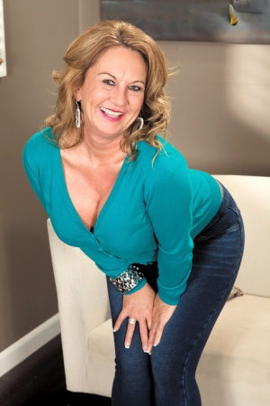 Smiley sexy mature Cali Houston drops her tight jeans for some big black cock
