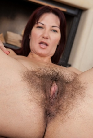 Big titted MILF Vanessa J strips to spread naked and show her hairy beaver