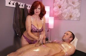 Redhead masseuse Andi James denies a client an orgasm after tugging his dick