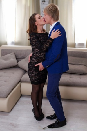 Brunette girl Emma Brown removes stockings and heels during a hard fuck