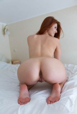 18 year old girl Alietta touts her bare ass while modeling naked on her bed