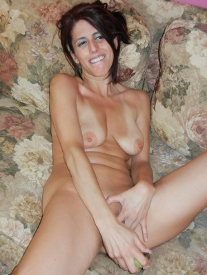 Brunette MILF Lavender Rayne masturbates with bananas on a couch