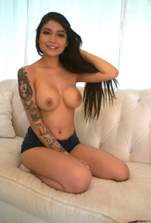 Busty and tattooed amateur sucks and fucks in POV mode on a sofa 44177613