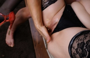 Busty older woman sports a creampie after sex with a younger man on a couch
