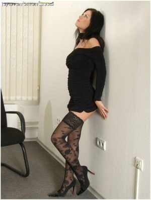 Dark haired teen Kate exposes her stocking tops during a non nude solo shoot 41699157