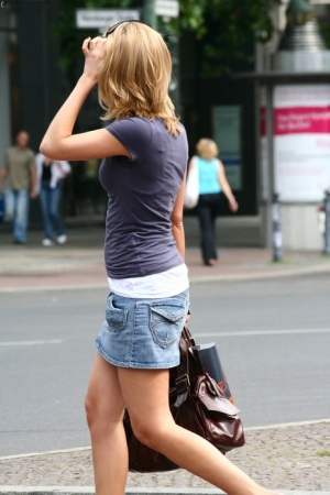 Clothed girls are secretly recorded by a voyeur while out in public