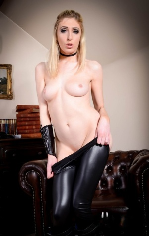 Sexy blonde Jessica Jensen wields a pistol while removing leather clothing