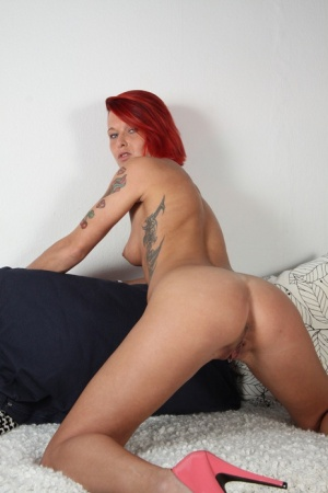 Redhead maid Wild Cherry gets banged and dildoed in pink high heels 95802164