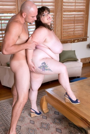 Obese woman Billie Austin has her huge tits played with before intercourse