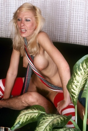Tall blonde sticks a bottle in her bush before sex on a sofa in long socks