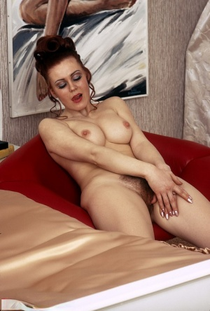 Busty redhead with a natural twat lets her hair down while exchanging oral sex