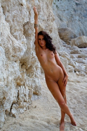 Centerfold model Barbora Kuzmiakova emerges from the sea with no clothes on