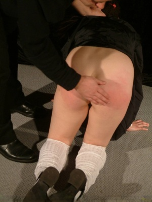 Asian schoolgirl has her plump ass turned red while being spanked