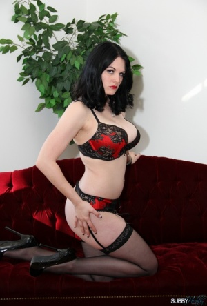 Dark-haired wife Shae Fatale ball gags and hog ties her submissive husband