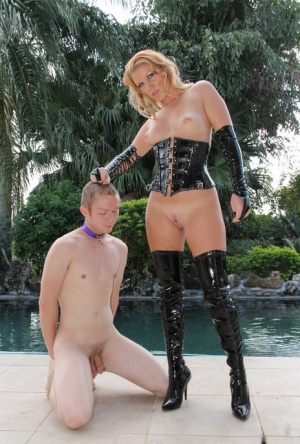 Blonde wife Ashley Edmunds dominates her hubby before locking him in a cage