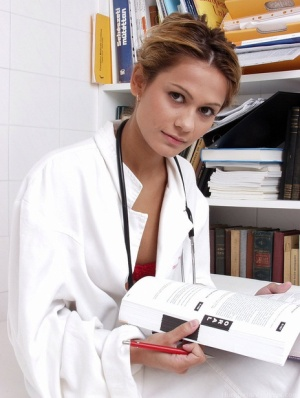 Solo girl removes her lab coat to model naked other than a stethoscope