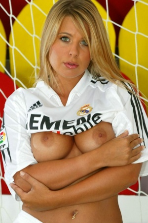 Blue-eyed blonde with big boobs rubs her pussy while tending soccer goal