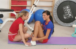Young lesbians kiss and toy pussies after their daily workout and yoga session