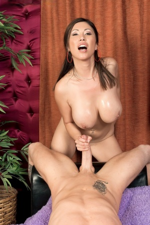 Asian MILF Kianna Dior uncorks her hooters before giving a handjob in the nude