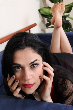 Bare legged brunette Chiara shows the soles of her feet in solo action
