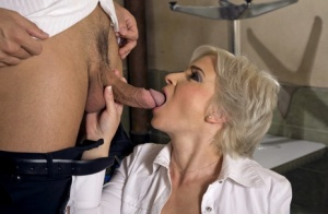 Sexy blonde manager seduces younger employee into anal sex in the workplace
